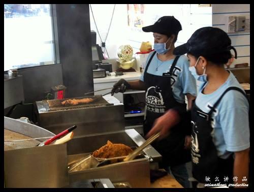 Workers frying chicken @